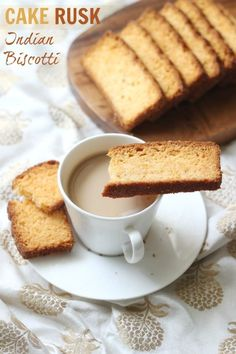 These crisp & delicious cake rusks are an Indian take on the biscotti! Served with a hot cup of tea or coffee, they make for a great tea time accompaniment! #ruchikrandhap #cakerusk #indianbiscotti #ruskrecipes #rusk #teatime #indianrecipes #biscotti