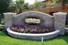entrance with flower bed and sign