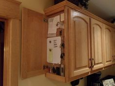"""The end cabinet message center houses our keys, the garage door transmitter, the digital weather station, a white board and more. With the 2"""" face frame cabinet the small amount of interior cabinet..."""