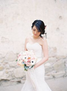 Bride looking timeless in a strapless wedding dress: http://www.stylemepretty.com/california-weddings/san-juan-capistrano/2016/09/23/old-world-elegance-meets-garden-romance/ Photography: Sposto - http://spostophotography.com/