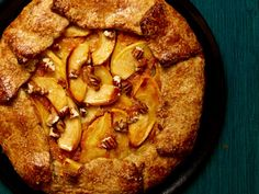 Apple-Pumpkin Galette : This rustic dessert combines the creaminess of pumpkin puree, the chunky texture of apples and the nuttiness of chopped pecans