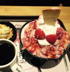 Strawberry and milk shaved ice with fresh cream and cheesecake on the top at Sul-Bing in Seoul. So far, this is my most favorite shaved ice in Korea. #strawberry #bingsu #shavedice #coffee #sulbing #strawberryandcream #cheesecake