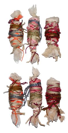 Caroline Sax - Fabric bundles with an assortment of different cords and twine.