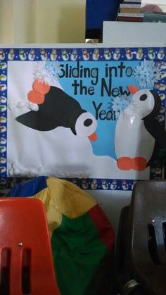 Pre k / preschool bulletin board for new years penguins sliding into the new year