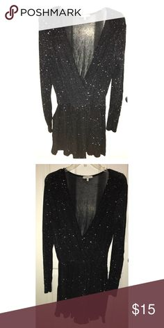 Charlotte Russe Long Sleeve Black Sparkly Romper Soft, long sleeve, black romper covered in sparkles. Deep crossing v-neck. Elastic waistband. Very comfortable fit. 94% nylon. 6% spandex. Charlotte Russe Dresses