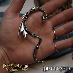 Best Seller! Alchemy Gothic E274R The Dragon's Lure Stud Ear-Wrap (right)  Like a whispering shoulder devil or a witch's familiar, this dragon, piercing through the ear lobe, tempts the wearer into acts of shameful depravity.