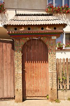 Traditional wooden Székely ( Szekely ) gates in a Szekely village near Cluj, Eastern Transylvania. Carved with folk art & painted the Szekely gate also has dove cotes above the gate. Old Gates, Wooden Gates, Gate House, Fence Gate, Entrance Gates, Pictures Images, Wood Carving, Hungary, Romania