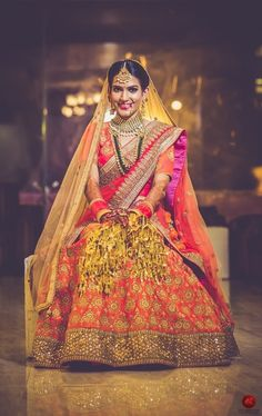 Bridal Lehenga - Red and Orange Bridal Lehenga | WedMeGood | Orange Lehenga with Gold Embroidery and Gold Border with a Red Choli and Double Net Dupatta #wedmegood #indianbride #indianwedding #gold #orange #kaleere #lehenga #bridal #indianlehenga