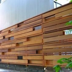 Love horizontal fencing. I've seen it with hanging pots really effectively.