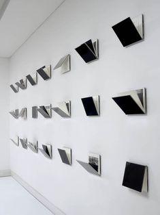 Fernanda Fragateiro. Measuring E1027 (21 handmade books, silk cover and acrylic; 150 x 25 x 550 cm). 2011. (via Arratia Beer, Berlin)