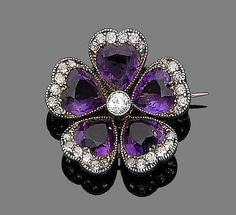 """An amethyst and diamond-set pansy brooch, c.1890 Each petal millegrain-set with a heart-shaped amethyst and highlighted by old brilliant and rose-cut diamonds, centrally set with a collet-set old brilliant-cut diamond; in the language of flowers, the pansy means 'think of me'."""