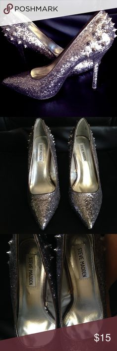 Steve Madden Silver Studded Glitter Pumps These babies have never been used or worn. I bought them ages ago and they have just been sitting in my closet. Please scroll through all 8 pictures to see details. Most everything is in excellent condition except for a couple flaws. The lining on the side of the insoles stick out slightly and this can be seen in pics 2-4. And please see the last 2 pics for slight discoloration on the right shoe. Does not come with the original shoe box and I will…