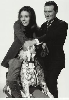 The Avengers mrs emma peel (diana rigg) & john steed (patrick macnee) on Rocking Horse