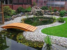 Garden pondlove the wooden bridges garden pond design fish pond gardens fish ponds backyard koi pond design ponds backyard outdoor fish ponds excellent patio decor information is available on our internet site have a look and gardenpond design Pond Landscaping, Landscaping With Rocks, Backyard Water Feature, Backyard Ponds, Garden Ponds, Backyard Ideas, Backyard Decorations, Desert Backyard, Garden Grass