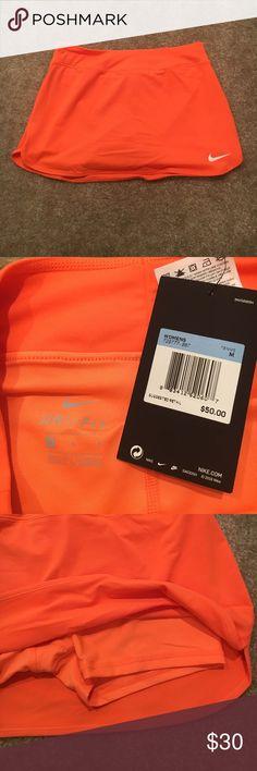 Nike Dri-Fit Tennis Skirt Bright orange Nike tennis skirt with built in spandex - TAGS STILL ON - never worn Nike Skirts