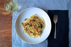 A date-worthy pasta recipe made with cream, white wine, butter, bacon, and plenty of vegetables.   Adapted from the back of the De Cecco pasta box.