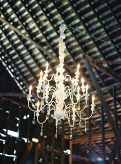 Chandelier in a barnyard- great way to fancy up a party space!