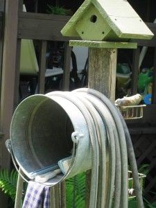 hang a bucket for hose storage