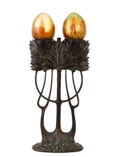 Gustav Gurschner (Muhldorf 1873-1970). Art Nouveau bronze double branch table lamp, c1900 cast in the shape of mistletoe branches, with original Loetz shades, stamped 'Gurschner, Deposer'. Height 31 cm.