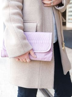 Her textured, pale pink #Foxy clutch adds a #feminine touch to her streamlined look.