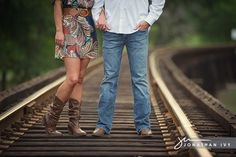 I like adding the railroad track. Normally I like boot shots but I think this one needed their faces in it. Maybe kissing or doing something cute :)