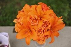 so much orange, i loved my bouquet! tiger lily and orange rose bouquet