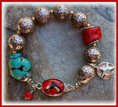 CowGirl at Heart  IN THE MIX A Chunky Turquoise & Coral nugget are the stars among these Hammered Hilltribe Silver beads. A splash a golden vermeil between the silver, a couple of Bali silver spacers and a wonderful vintage glass clasp.  SIZING IT UP This bracelet is generously sized at.......8.0 inches fits a wrist size 6.75 to 7.25 perfect!!!
