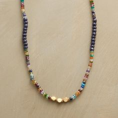 "OUT OF THE BLUE NECKLACE -- Surprise someone or treat yourself to the cool blue of faceted sapphires accompanied by a colorful collection of semiprecious stones—garnet, apatite, citrine, white topaz, peridot, amethyst, pink tourmaline and iolite—and 22kt gold-plated beads. USA. Exclusive. 36""L."