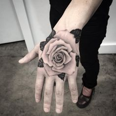 Hand rose tattoo by Elisabeth Markov.   Rose tattoos are one of the most sought after tattoos in the world and has always been a classic symbol of beauty, balance and love. Enjoy!