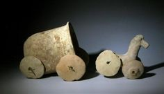 "From the ancient Near East, Syria, ca. 1000 to 800 BC. Delightful terracotta child's toy in the form of a covered cart and horse - each with original four wheels. Entire unit measures 9""L x 4-1/2""H, wheels once applied using wooden dowels which have been lost to age."