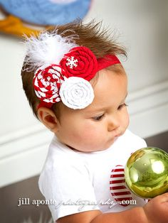 Inspiration - Christmas red and white rolled fabric rosette with white feathers