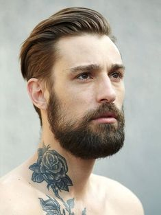 Rose neck tattoo and this man's hair is freaking perfect!
