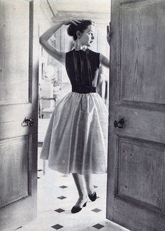Model wearing a skirt and blouse, 1950s.