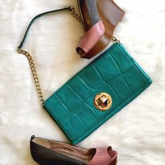 """Kate Spade Embossed Teal Shoulder Bag A gorgeous pop of color! Pyramid lock, gold shoulder chain with leather section, no flaws or marks! Measures approximately 10"""" x 6"""" with a 9"""" drop from the strap. Color is slightly lighter than it photographed. kate spade Bags Shoulder Bags"""
