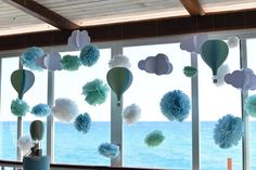 My decoration: hot air balloons, clouds and pon pon. Green, blue and white. For a baptism.