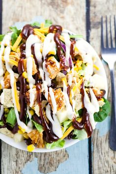 Barbecue Ranch Chicken Salad Recipe - Quick and easy Barbecue Ranch Chicken Salad with crisp green lettuce, corn, black beans, and grilled barbecue chicken makes a perfect, fresh salad for lunch or dinner. Perfect for using up leftovers!