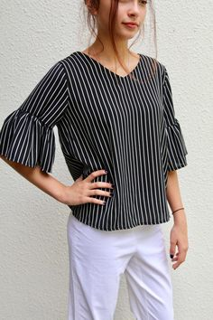Belle Sleeve Top Free Sewing Pattern And Tutorial | This chic and sophisticated DIY top is perfect for pairing with jeans and flats!