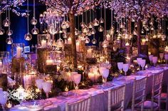 Tealights and pillar candles fill a room with glowing light~ Red floral architecture