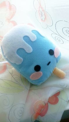 Image from http://img00.deviantart.net/9d9c/i/2013/003/8/4/kawaii_popsicle_w__frosting_plushie_by_ilybunnies-d5qbnvm.jpg.