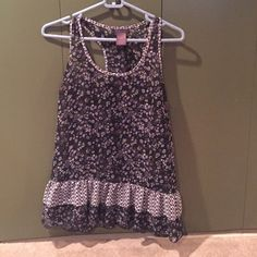 Peplum style tank. Peplum style tank top. Black with purple blue and white flowers. Pretty ruffle detail at waist. Sheer but with all flowers you can get away with not wearing a cami underneath. EUC. Tops Tank Tops