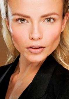 Top make-up trends for Fall 2012: Bronzed at Emilio Pucci.    Accentuate facial contours with different foundation shades. Dark powders emphasize cheekbones while light powders highlight the apples of your cheeks, both bringing a bronzed appeal that warms the complexion.