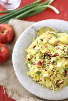 1 (3 lb.) spaghetti squash  4 tbsp extra virgin olive oil  1 tbsp plus 1 tsp apple cider vinegar  1/4 tsp kosher salt  2 medium Gala apples, cut into 1/2-inch cubes  1/2 cup pecans, roughly chopped and toasted  3 green onions (white & green parts), thinly sliced  nuke15 min. whisk and add dressing, stir in rest of ingred.