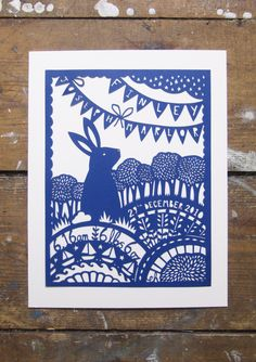 A5 commission for the birth of Finley. Cut from a piece of blue paper. Emily Hogarth.