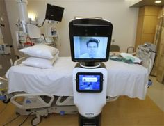 Robots let doctors 'beam' into remote US hospitals. In this photo taken Wednesday, Nov. 6, 2013 Dr. Alan Shatzel, medical director of the Mercy Telehealth Network, is displayed on the monitor RP-VITA robot as he waits to confer with Dr. Alex Nee at Mercy San Juan Hospital.