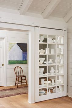 An unusual nook, original to the home, features a sliding door and display area that's perfect for Dana's collection of ironstone and milk pottery, which she finds at estate sales and antiques stores.
