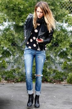 Snapped in the City of Angels, the American actress was grunge-chic in a studded biker blazer and distressed denim with a polka-dot sweater and cowboy ankle boo