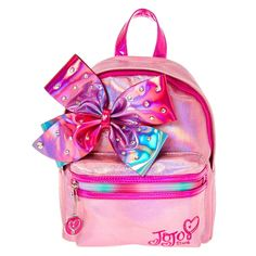 Jojo Siwa Pink Shimmer Bedazzled Bow Mini Backpack | Get sassy school style like Jojo Siwa with this backpack from her collection. The pink backpack has a shimmery finish and embellished with a large bedazzled ombre bow. It features a front zipper pocket for extra storage.