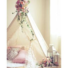 How beautifully staged is this? The addition of flowers atop a tent for a dreamy girls room or a baby girl nursery, Mom and Baby can just camp out for the afternoon.Just divine. Found by TheresaStudioArtWorks.com maker of magical mobiles.