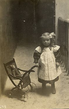 Such a sad looking little girl with her small dolly..about 1910/20 ?