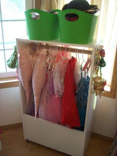 Dress-Up Storage from old bookshelf, mirror on the side, command hooks on the other side for jewelry. Keep a shelf on the bottom to make basket drawers for accessories!